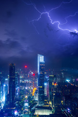 Night cityscape of guangzhou urban skyscrapers at storm with lightning  bolts in night purple blue sky, Guangzhou, China