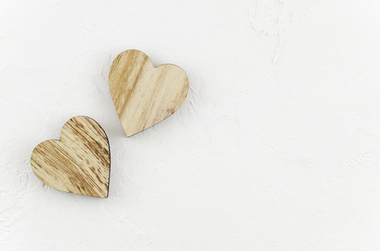 Two wooden hearts placed nicely on a white background. Valentines day concept. Lovely mockup with copy space.Minimal flat lay design. Top view