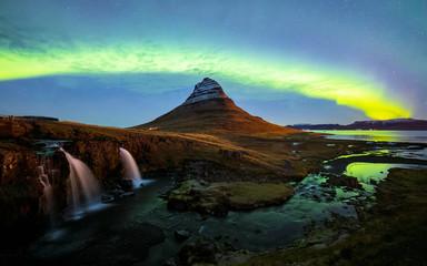 Northern light (Aurora Borealis) over Kirkjufell mountain in iceland