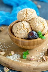 Homemade Moroccan sesame cookies in a wooden bowl.