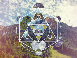 Collage with the mountains and forest and the sacred geometry symbol Fototapete