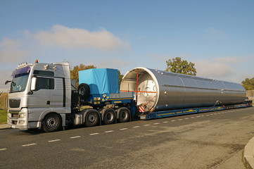 Oversize Load or exceptional convoy. A truck with a special semi-trailer for transporting oversized loads. Wall mural