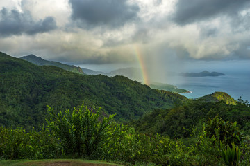 rainbow and rain over the jungle and mountains of mahé, seychelles 9