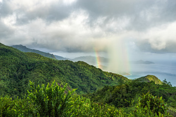 rainbow and rain over the jungle and mountains of mahé, seychelles 14