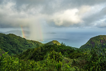 rainbow and rain over the jungle and mountains of mahé, seychelles 15