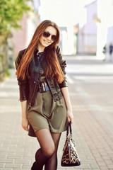 Beautiful pretty woman walking on a street