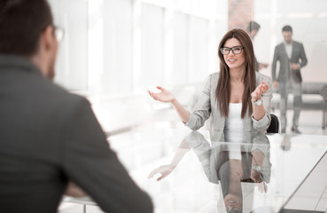business woman discusses with the client the terms of the contract