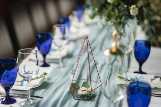 Elements of wedding decoration in restaurant. Green and blue color