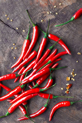 Canvas Prints Hot chili peppers Close-up on red hot chili peppers on rustic wood, flat lay