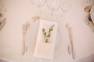table appointments in restaurant. wedding decoration with floral elements