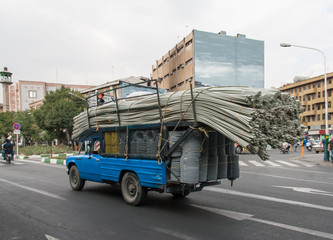 Overloaded truck with tubes