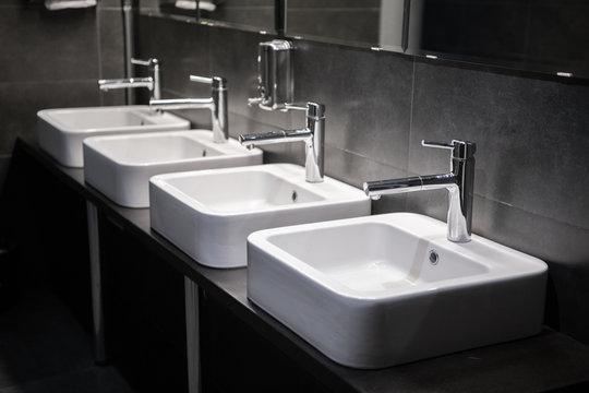 Modern sinks with mirror in public toilet