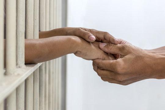 Hand handshake husband and wife who were imprisoned.