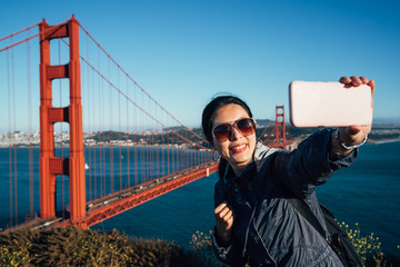 female tourist taking selfie in San Francisco