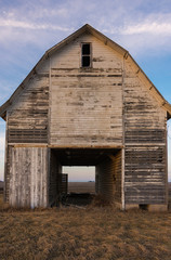 Old rustic barn as the sun sets.  Ogle County, Illinois, USA