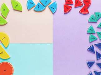 colorful math fractions on the bright backgrounds. interesting math for kids. Education, back to school concept. Geometry and mathematics materials.