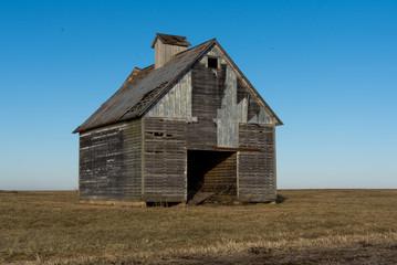 Old wooden barns in the open farmland.  LaSalle County, Illinois, USA