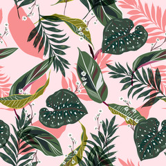 Bright and fresh tropical leaves. Seamless graphic design with palms leaves and flowers. Fashion,fabric and all prints