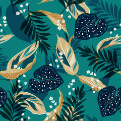 Beautiful tropical leaves. Seamless graphic design with palms leaves and flowers. Fashion,fabric and all prints