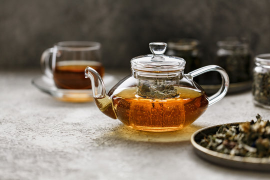 Teapot with fresh tea from different herbs.