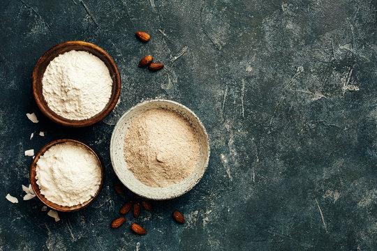 Wooden bowls of various flour
