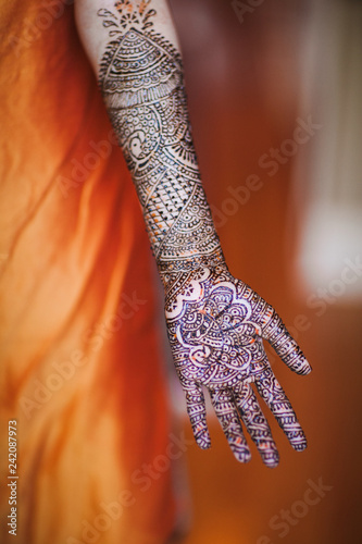indian woman with henna tattoos for a wedding