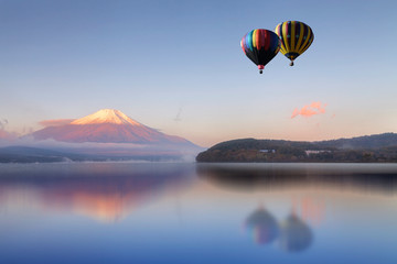 Hot air balloon flying  over the lake with Mount Fuji in background