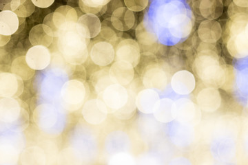 blurred bokeh, background with bright colored lights of Christmas and happy New year
