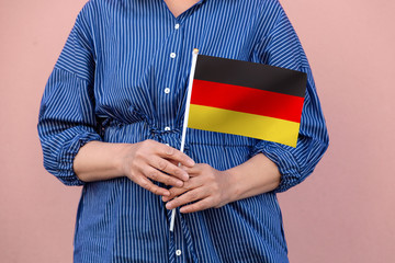 Germany flag. Close up of hands holding Germany Deutschland flag.