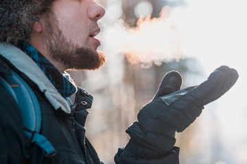 A man breathe outdoor in cold winter