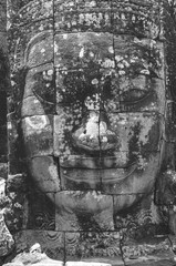 Anciente stone heads in Bayon temple in Angkor Wat, Cambodia in black and white