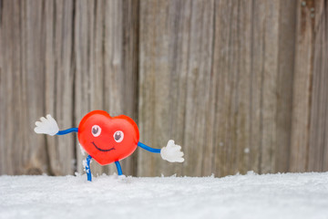 toy in the form of a heart for the day of lovers, preparation for the day of lovers, a heart in the snow