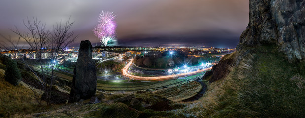 Huge Panorama of Edinburgh's Hogmanay Torchlight procession with fireworks in background
