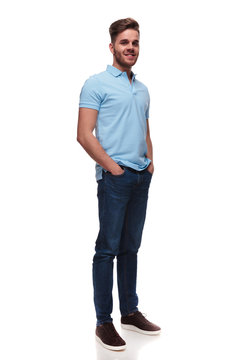 relaxed casual man in polo shirt standing and holding pockets