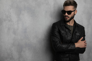 portrait of confident man in leather jacket looking to side Wall mural