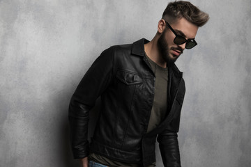 portrait of relaxed casual man with sunglasses looking to side