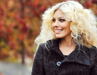 Beautiful curly blonde woman portrait