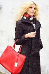 Fashion street portrait of beautiful blonde woman with bag - outdoor