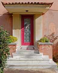 vintage house entrance with red frame door, Athens Greece