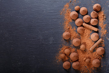 chocolate truffles candies on dark background
