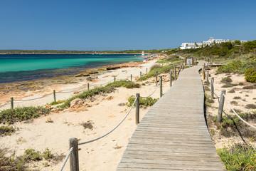 Wooden walking path along the Migjorn beach, Formentera island. Spain.