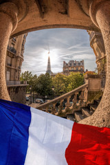 Wall Mural - Romantic street view with Eiffel Tower against french flag in Paris, France