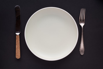 Vintage silver plate, spoon and fork on black background