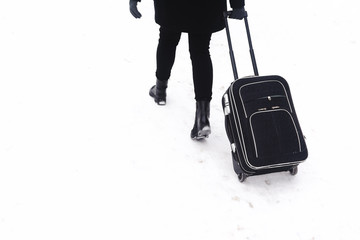 the girl with the black suitcase