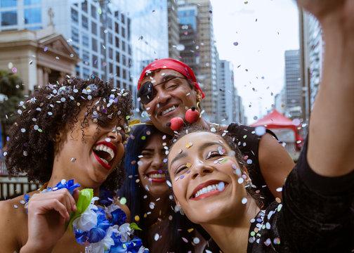 Carnaval party. Group of Brazil people in costume celebrating carnival in the city. Dressed brazilian having fun in parade festival.