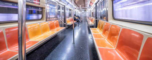 Poster New York City NEW YORK CITY - DECEMBER 2018: Interior of New York City subway train, wide angle view