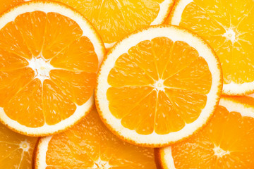 Round cut slices of ripe juicy organic oranges. Pattern top view flat lay. Vibrant color. Vitamins healthy lifestyle vegan superfoods concept. Poster banner
