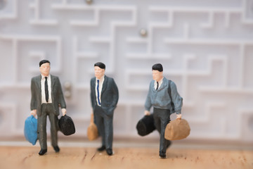 Miniature people: Businessman leave from maze  to the future concept