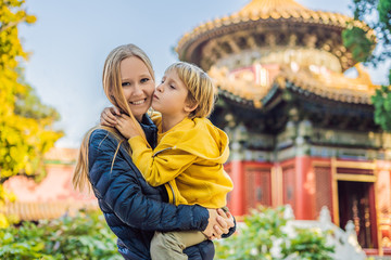 Enjoying vacation in China. Mom and son in Forbidden City. Travel to China with kids concept. Visa free transit 72 hours, 144 hours in China