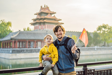 Enjoying vacation in China. Happy family with national chinese flag in Forbidden City. Travel to China with kids concept. Visa free transit 72 hours, 144 hours in China